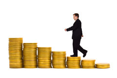 Businessman on money staircase. Isolated on white background stock images