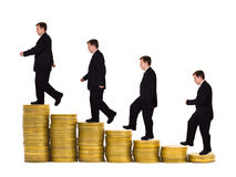Businessman on money staircase. Isolated on white background stock photography