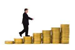 Businessman on money staircase. Isolated on white background royalty free stock photos