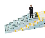 Businessman and money staircase. Isolated on white background stock images
