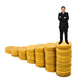 Businessman on money stairs. Isolated on white background stock photo