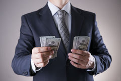 Businessman with money in studio. Corruption concept. Hundred dollar bills Royalty Free Stock Photos