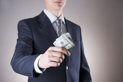 Businessman with money in studio. Corruption concept. Hundred dollar bills Royalty Free Stock Image