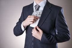 Businessman with money in studio. Corruption concept. Hundred dollar bills Stock Photography