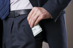 Businessman with money in studio Stock Photography