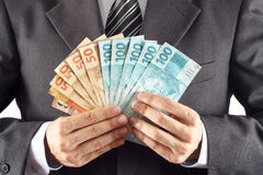 Businessman with money Royalty Free Stock Images