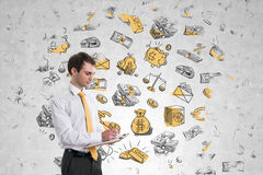 Businessman on money wall Royalty Free Stock Photo