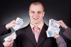 Businessman with money. Young handsome businessman with money Royalty Free Stock Photography