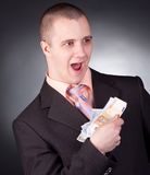 Businessman with money Stock Photo