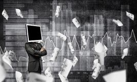 Businessman with monitor instead of head. Businessman in suit with monitor instead of head keeping arms crossed while standing against flying papers and Stock Image