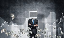 Businessman with monitor instead of head. Businessman in suit with monitor instead of head keeping arms crossed while standing against flying dollars and Royalty Free Stock Photography