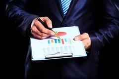Businessman monitoring stock market Stock Photo