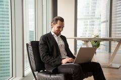 Businessman monitors financial indicators online Royalty Free Stock Photography