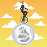 Businessman in monocycle over a coin Royalty Free Stock Photo