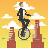 Businessman in monocycle over a high wire in a city. The grunge texture is removable from the background Stock Photos