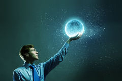 Businessman with moon Stock Image