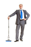 Businessman with a mop Stock Photography
