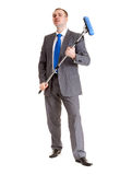 Businessman with a mop Royalty Free Stock Photography