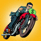 Businessman on a motorcycle. Financial success. Pop art retro style. The dollar sign instead of the number of transport Royalty Free Stock Images