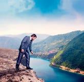 Businessman on the mountain edge Stock Photo