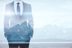 Businessman on mountains background multiexposure Royalty Free Stock Images