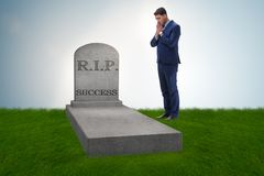 The businessman mourning the death of success. Businessman mourning the death of success Royalty Free Stock Photography