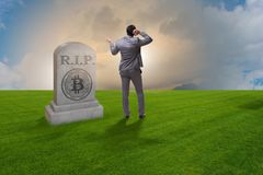The businessman mourning the demise and death of bitcoin. Businessman mourning the demise and death of bitcoin Stock Image