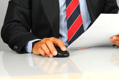 Businessman with mouse Stock Images