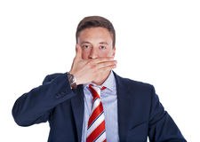 Businessman with mouth closed Stock Images