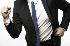 Businessman on the move with clenched fists Stock Photography