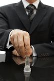 Businessman Moves Chess King Figure Royalty Free Stock Photography