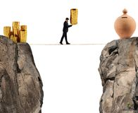 Businessman moves a pile of coins to a moneybox. concept of difficulty to saving money. Businessman moves a pile of golden coins to a moneybox. concept of Stock Images