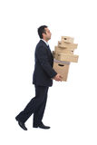 Businessman moving house Royalty Free Stock Photos