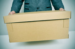Businessman moving office. A businessman carrying a box, leaving or moving to a new office Stock Photography