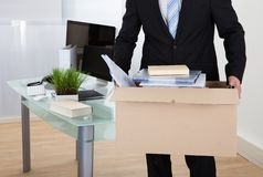 Businessman moving offices Royalty Free Stock Photo
