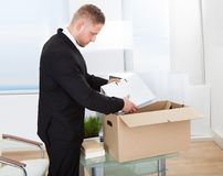 Businessman moving offices Royalty Free Stock Photos