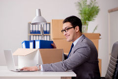 The businessman moving offices after promotion Stock Image