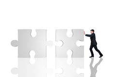 Businessman moving puzzle Stock Image