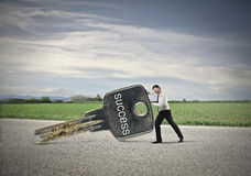 Businessman moving the success. Businessman moving the key of success Stock Photo