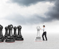 Businessman moving white pawns. Close up Royalty Free Stock Photos