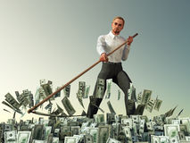 Businessman mowing scythe money. Strong businessman mowing scythe money Royalty Free Stock Photo