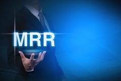 Businessman with MRR word . Stock Photos