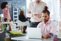 Businessman in multi-generational office stock image