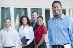 Businessman With Multiethnic Executives Behind Stock Photos