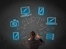 Businessman with multimedia icons over his head Royalty Free Stock Image