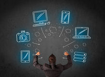 Businessman with multimedia icons over his head Stock Images