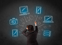 Businessman with multimedia icons over his head Stock Photos