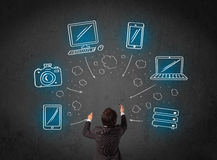 Businessman with multimedia icons over his head Royalty Free Stock Photo