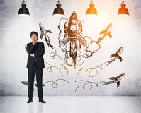 Businessman and multiple rocket sketches Royalty Free Stock Photos