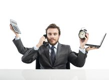 Businessman multitasking Stock Photography